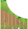 Wooden fence and lush foliage vector image