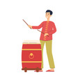 cartoon man playing red chinese drum in vector image