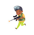 cute little african american boy playing paintball vector image vector image