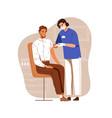 nurse vaccinating man with anti-virus vaccine vector image
