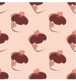 Tile pattern with cupcakes on pink background vector image