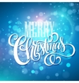 Merry christmas handwritten text on blue bokeh vector image
