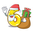 santa with gift number six isolated on the mascot vector image