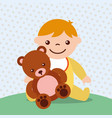 cute toddler boy with bear teddy toy vector image
