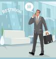 happy businessman in restroom at work vector image