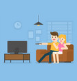 young couple watching television at home vector image