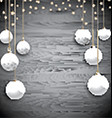 Hanging Christmas baubles on a wooden background vector image vector image