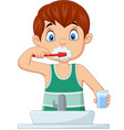 cute little boy brushing teeth vector image vector image