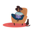 girl reading book in armchair cat sitting vector image vector image