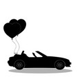 black silhouette of opened car with pair of heart vector image
