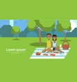 city park african couple sitting picnic eating on vector image vector image