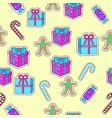 gift boxes candy sticks gingerbread boy seamless vector image