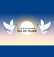 international day of peace pair of pigeons hold an vector image vector image