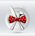 fork table knife and bow tie on a plate vector image