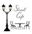 street cafe - table chairs streetlight and vector image