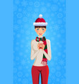 cute girl with brown hair dressed in santa hat vector image vector image