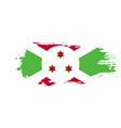 grunge brush stroke with burundi national flag vector image vector image