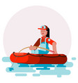 woman in boat caching a fish vector image
