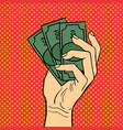 pop art hand money vector image vector image