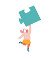 young woman carry huge puzzle piece in raised hand vector image