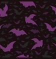 flying purple halloween bats pattern vector image vector image