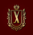 golden royal coat of arms with x monogram vector image vector image