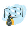 woman looking at the flight information board vector image