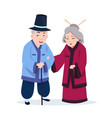 senior asian couple wearing traditional costumes vector image vector image