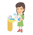 little caucasian girl washing dishes in the sink vector image