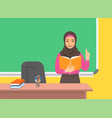 arab teacher reads book near blackboard in class vector image vector image