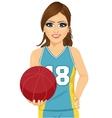 female basketball player holding ball vector image vector image