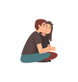 young man and beautiful woman sitting on ground vector image vector image
