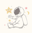 baby astronaut plays with stars