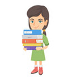 caucasian school child holding pile of textbooks vector image vector image