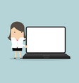 businesswoman pointing to laptop display vector image vector image