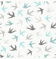 seamless pattern with a flock of swallows vector image