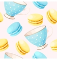 Seamless teacups and macarons vector image