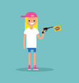 young female character holding a toy gun with a vector image vector image