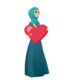 muslim business woman holding a big red heart vector image vector image