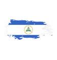 grunge brush stroke with nicaragua national flag vector image