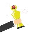 Hand holding winners trophy award vector image