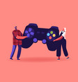 tiny male and female characters playing videogame vector image vector image