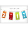Four colorful hanging labels with 2017 year vector image vector image
