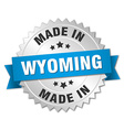 made in Wyoming silver badge with blue ribbon vector image vector image