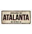 welcome to atalanta vintage rusty metal sign vector image vector image