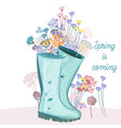fashion spring with blue rubber boots and flowers vector image vector image