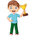 cartoon little boy holding gold trophy vector image