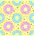 donuts with pink and blue icing and chocolate vector image vector image