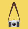 hanging old camera in a flat style with strap vector image vector image