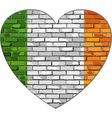 Ireland flag on a brick wall in heart shape vector image vector image
